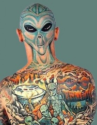Original alien face tattoo on back